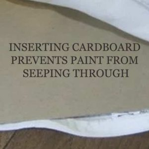 Inserting cardboard protects back side from paint seepage